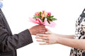 Woman recieving flowers a a bouquet of pink from her husband Royalty Free Stock Photography