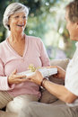 Woman recieving gift on their anniversary Stock Photo