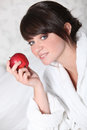 Woman with a red apple Royalty Free Stock Image
