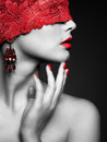 Woman with red bandage young beautiful on eyes Stock Photos