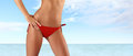 Woman in red bikini on sea and sky background Royalty Free Stock Photo