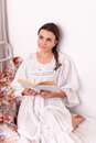 Woman red book in a bed Royalty Free Stock Photography