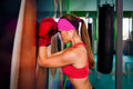 Woman red boxing gloves beautiful in next to pear Stock Image