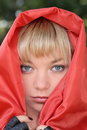 Woman in red cloak Stock Photos