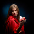 Woman with red cloak holding pomegranate beautiful in studio Stock Images