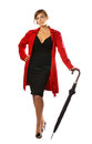 A woman in a red coat and holding an umbrella Royalty Free Stock Photos