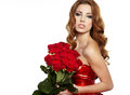 Woman in red drapery with red roses Royalty Free Stock Photo