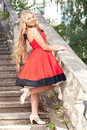 Woman in red dress beautiful young a s standing on an old stone staircase Stock Photography