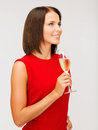 Woman in red dress with a glass of champagne party drinks christmas x mas concept smiling Royalty Free Stock Image