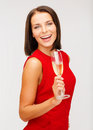 Woman in red dress with a glass of champagne party drinks christmas x mas concept smiling Stock Photography