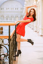 Woman in red dress about handrail Royalty Free Stock Image