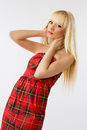 Woman in red dress with long blonde hair Royalty Free Stock Images