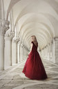 Woman in red dress near san marco square venice ancient columns italy Stock Photos