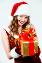 Woman in a red dress of Santa with a big gift Royalty Free Stock Image