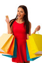 Woman in red dress with shopping bags excited of purchase in mall. Royalty Free Stock Photo