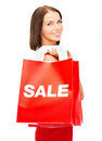 Woman in red dress with shopping bags sale gifts christmas x mas concept smiling Royalty Free Stock Photos