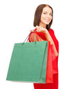 Woman in red dress with shopping bags sale gifts christmas x mas concept smiling Stock Photography