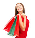 Woman in red dress with shopping bags sale gifts christmas x mas concept smiling Stock Photos