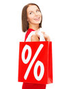 Woman in red dress with shopping bags sale gifts christmas x mas concept smiling and percent sign Royalty Free Stock Photography