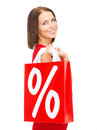 Woman in red dress with shopping bags sale gifts christmas x mas concept smiling and percent sign Royalty Free Stock Images