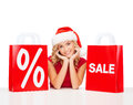 Woman in red dress with shopping bags sale gifts christmas x mas concept smiling and santa helper hat Stock Images