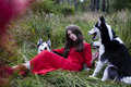 Woman in red dress with tree wolfs in forest weard picture Stock Photos