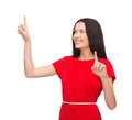 Woman in red dress working with virtual screen technology concept attractive young Royalty Free Stock Photos