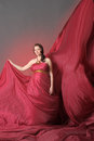 Woman in red flying dress