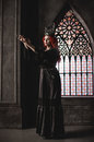 Woman with red hair in royal garb wearing elegant and crown ancient castle Royalty Free Stock Images