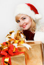 Woman in a red hat of Santa with a big gift Stock Photos