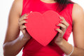 Woman with red heart shaped gift box Royalty Free Stock Photo