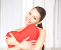 Woman with red heart-shaped pillow Royalty Free Stock Image