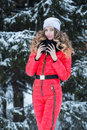 Woman in a red jumpsuit in the winter Royalty Free Stock Photo