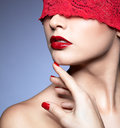 Woman with red lacy ribbon on eyes portrait of young beautiful Royalty Free Stock Images
