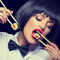 Woman with red lips eating sushi Royalty Free Stock Photo