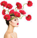 Woman with red poppy flowers beauty fashion model in her hair Stock Photos