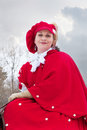 Woman in red riding habit Royalty Free Stock Image