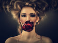 Woman with red rose and drops in hair Royalty Free Stock Photo