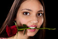 Woman with red rose in her mouth Stock Image