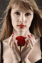 Woman with red rose luxure in lingerie Stock Images