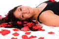 Woman with red rose petals. Royalty Free Stock Photography
