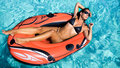 Woman in a red rubber boat is taking sunbath Royalty Free Stock Images