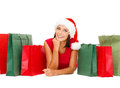 Woman in red shirt with shopping bags sale gifts christmas x mas concept smiling and santa helper hat Stock Photos