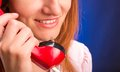 Woman with red telephone redhead smiling closeup Royalty Free Stock Photo
