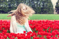 Woman in a red tulip field beautiful young waving head outdoor Stock Photos