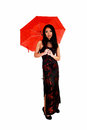 Woman with red umbrella a lovely young chinese in a black and long dress holding a for white background Royalty Free Stock Image