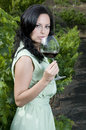 Woman with red wine glass in a vineyard Royalty Free Stock Photos
