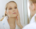 Woman reflaction in mirror Stock Image