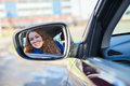 Woman reflection in car back rear-view Royalty Free Stock Photo