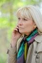 Woman reflective phoning senior outdoor Royalty Free Stock Image